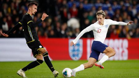Kosovo's Arbenit Xhemajli (left) and England's Todd Cantwell battle for the ball during the 2019 UEF