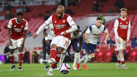 Arsenal striker Alexandre Lacazette slots home from the penalty spot against rivals Tottenham Hotspur at the Emirates Stadium