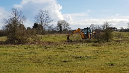 A digger working at the Smallford Pits site.