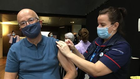 Harpenden resident Peter Farrimond receiving his COVID-19 vaccine from clinical lead CarolineShepherd at the Alban Arena...