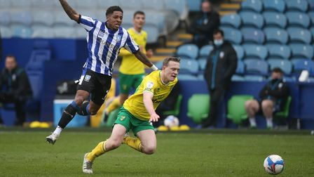 Oliver Skipp of Norwich is fouled by Kadeem Harris of Sheffield Wednesday during the Sky Bet Champio