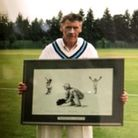Fred Standen with the signed print of ex-England wicket keeper Jack Russell.