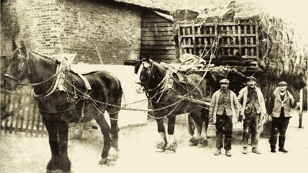The Claydon family and their horse-drawn wagon outside The Thatched House in the early 1900s