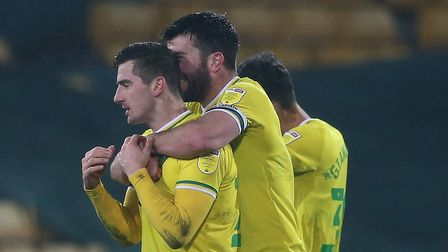 Kenny McLean of Norwich and Grant Hanley of Norwich celebrate victory at the end of the Sky Bet Cham