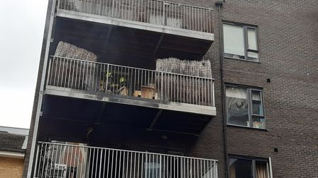 Firefighters can be seen working to control the blaze at a block of flats in Collent Street.