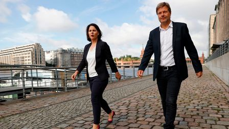 Co-leaders of Germany's Green Party Annalena Baerbock and Robert Habeck walk along Berlin'sriver Spree