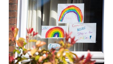 Houses and shops around Ipswich have been putting up rainbows and messages in their windows