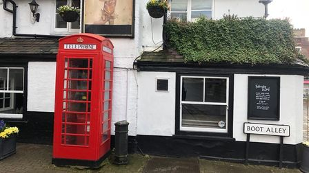 The red phone box outside The Boot pub in St Albans.