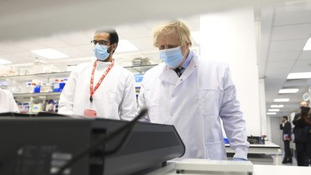 Prime Minister Boris Johnson (right) is shown the latest technology by PHD student Ahmed Elkaskis du