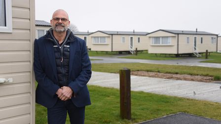 Richardson's chief executive, Greg Munford, with some of the new holiday homes at the Hemsby Beach H