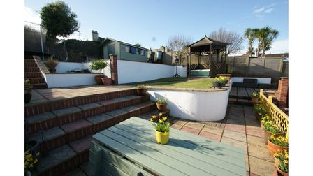 Thebeautifully maintained landscaped garden enjoys a southerly aspect and sea views towards Torquay.