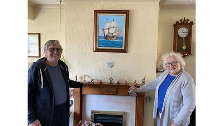 Couple in lounge with Mayflower painting on wall