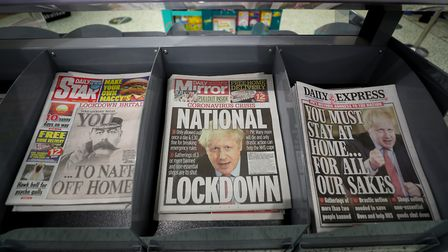 Newspapers displayed at a local shop the day after Boris Johnson put the UK in lockdown to help curb