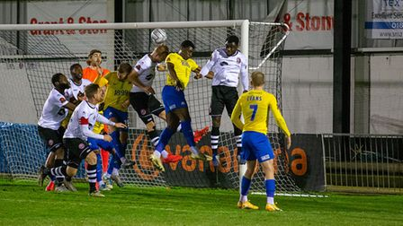 Sam Barratt of Maidenhead Utd clears the danger from a corner during the National League Match betwe