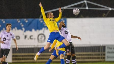 Connor Lemonheigh-Evans of Torquay United and James Comley of Maidenhead Utd battle for the ball dur