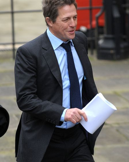 LONDON, ENGLAND - NOVEMBER 21: Hugh Grant arrives to give evidence at The Leveson Inquiry at The Ro