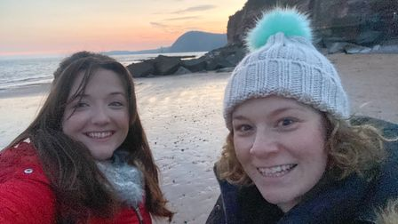 Ella and Charlie enjoy a sunset walk along Sidmouth before the pandemic