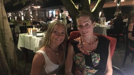A mother and daughter out for dinner in a restaurant