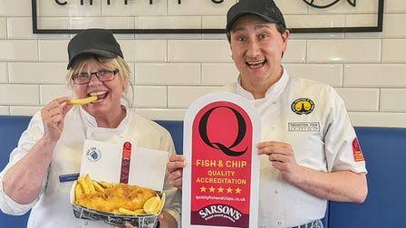 Paignton Pier Chippy owner Lorraine Arnold and shop manager James Astles celebrate the success.