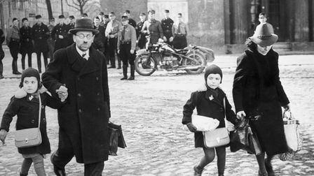 Uniformed Nazis watch a family of refugee Jews fleeing from Memel – now Klaipėda – after it was occupied by Germany in 1939