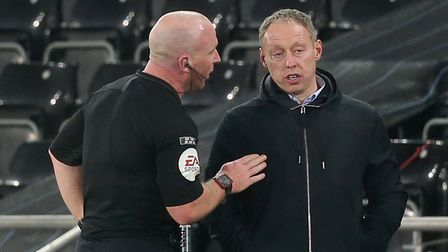 Referee Simon Hooper talks with Swansea City Manager Steve Cooper on the touchline during the Sky Be