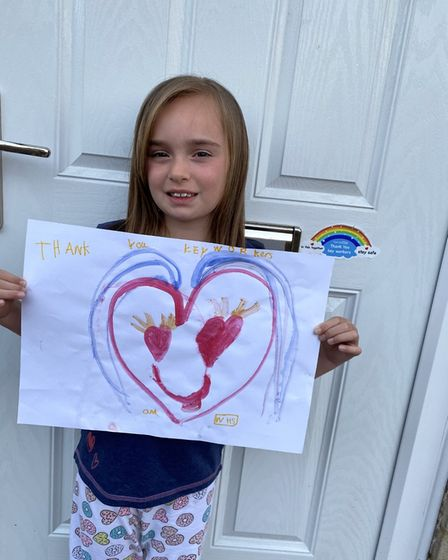 Lily Thorpe, from Maple Drive, in Huntingdon, make her own 'thank you' message for healthcare staff.