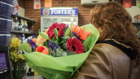 Mayor Heather Asker and a surprise bouquet at East Street Store
