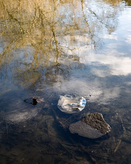 A plastic bag floats in the river Lea.