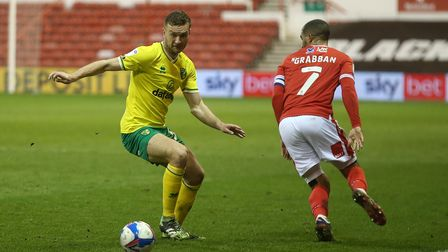 Ben Gibson of Norwich and Lewis Grabban of Nottingham Forest in action during the Sky Bet Championsh
