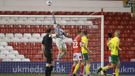 Tim Krul of Norwich tips the ball over the bar from a header by Tobias Figueiredo of Nottingham Fore