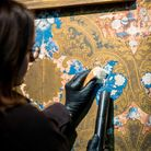 English Heritage conservators try using bread to wipe-down wallpaper. Audley End House is part of group