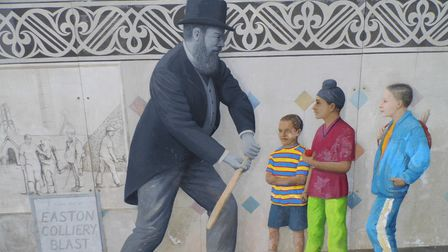 Mural at Stapleton Road railway station, Easton, Bristol, showing W.G. Grace in typical pose