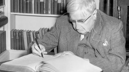 Ralph Vaughan Williams late in life, 1954, signing the visitors' book at Yale University