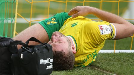 Ben Gibson was stretchered off with a suspected ankle injury in Norwich City's 1-1 Championship draw against Blackburn