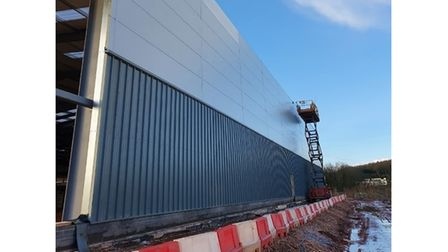 Outside picture of silver-coloured new factory building