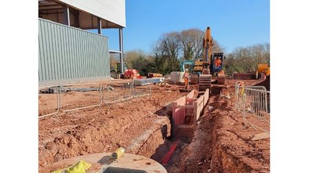 Digger working on new factory site