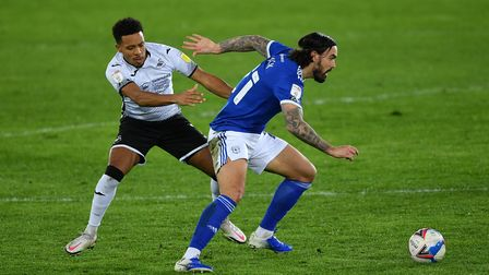 Swansea City's Korey Smith (left) and Cardiff City's Marlon Pack battle for the ball during the Sky