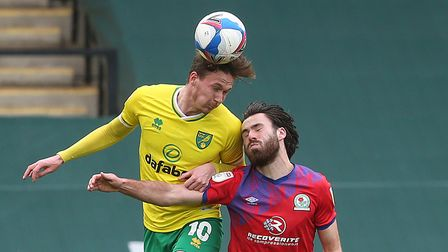 Kieran Dowell of Norwich and Ben Brereton of Blackburn Rovers in action during the Sky Bet Champions