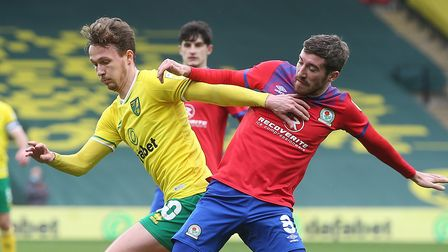 Kieran Dowell of Norwich and Joe Rothwell of Blackburn Rovers in action during the Sky Bet Champions