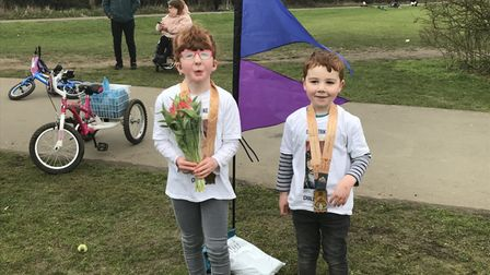 Isla and Dillion at the finish line on Saturday.
