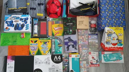 An assortment of toys, shoes and art supplies.