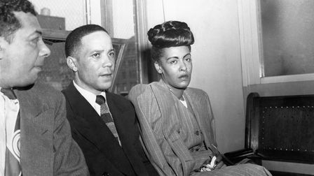PHILADELPHIA - MAY 20: Jazz singer Billie Holiday (R) is read the charge for heroin possession at t