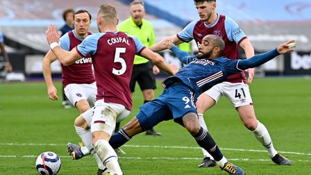 Arsenal's Alexandre Lacazette (centre) battles for the ball with West Ham United's Vladimir Coufal (