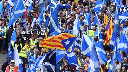 CatalanEstelada flags fly alongside Saltires at a pro-Scottish independence march in Glasgow in May, 2019