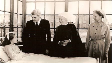 Labourhealth minister Nye Bevan visits 13 year old Sylvia Diggery Park Hospital Manchester July 5, 1948