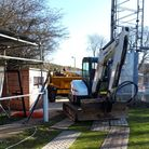 The digger moves in at Rothamsted Park as Harpenden Town begin improvement work.