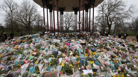 Floral tributes left at the bandstand in Clapham Common, London, for murdered Sarah Everard. Picture
