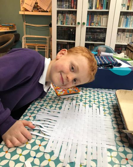 Fraser from 5th Saffron Walden Aztecs Cubs taking part in the Egypt Challenge - Egypt is known for papyrus