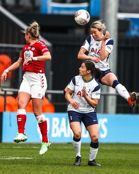 Tottenham Hotspur's Alanna Kennedy (right) heads the ball towards goal during the FA Women's Super L