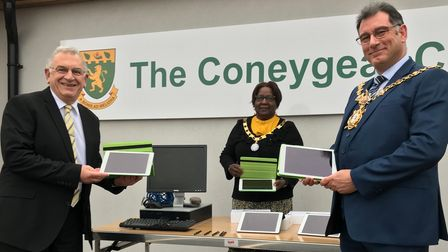 Thousands of pounds of refurbished iPads to Huntingdon Mayor Cllr Karl Webb.